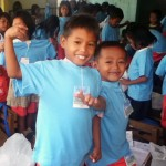 Children from the Philippines wearing donated Frugi T-shirts