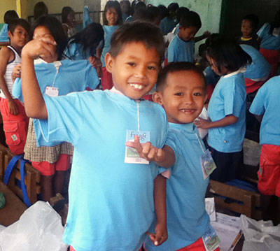 Children from the Philippines wearing donated Frugi T-shirts and shorts